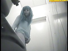 14 pictures - Chicks' gushing slits filmed by spy cam in toilet