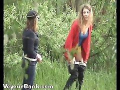 14 pictures - Yummy ladies tinkling outdoors - next to a spy cam